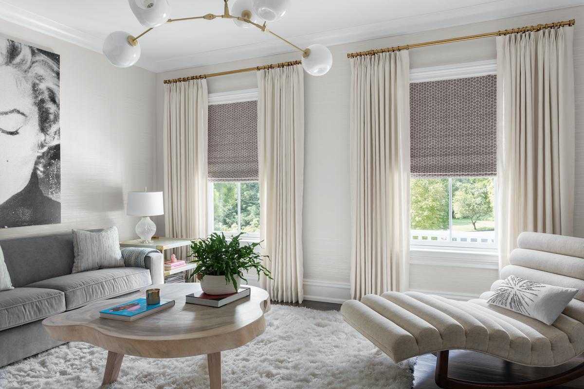 Drapery paired with roman shades in a contemporary living room