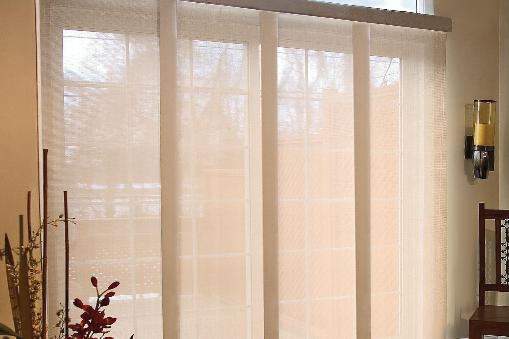 Tan solar shade panel tracks cover a large sliding glass door