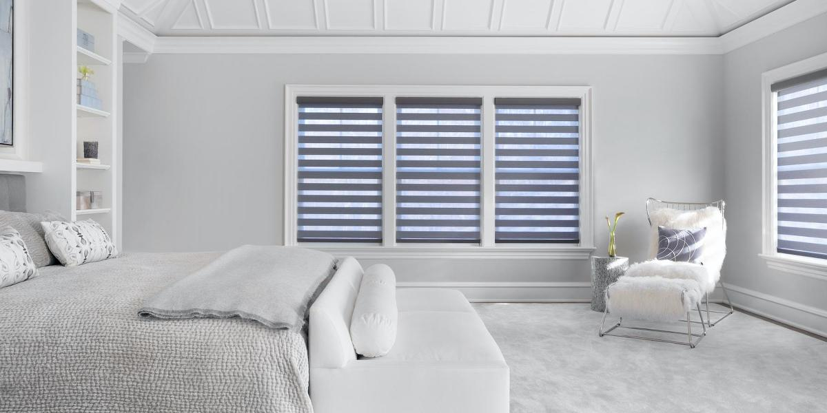 Cascade sheer shades cover 4 windows in a large, contemporary bedroom