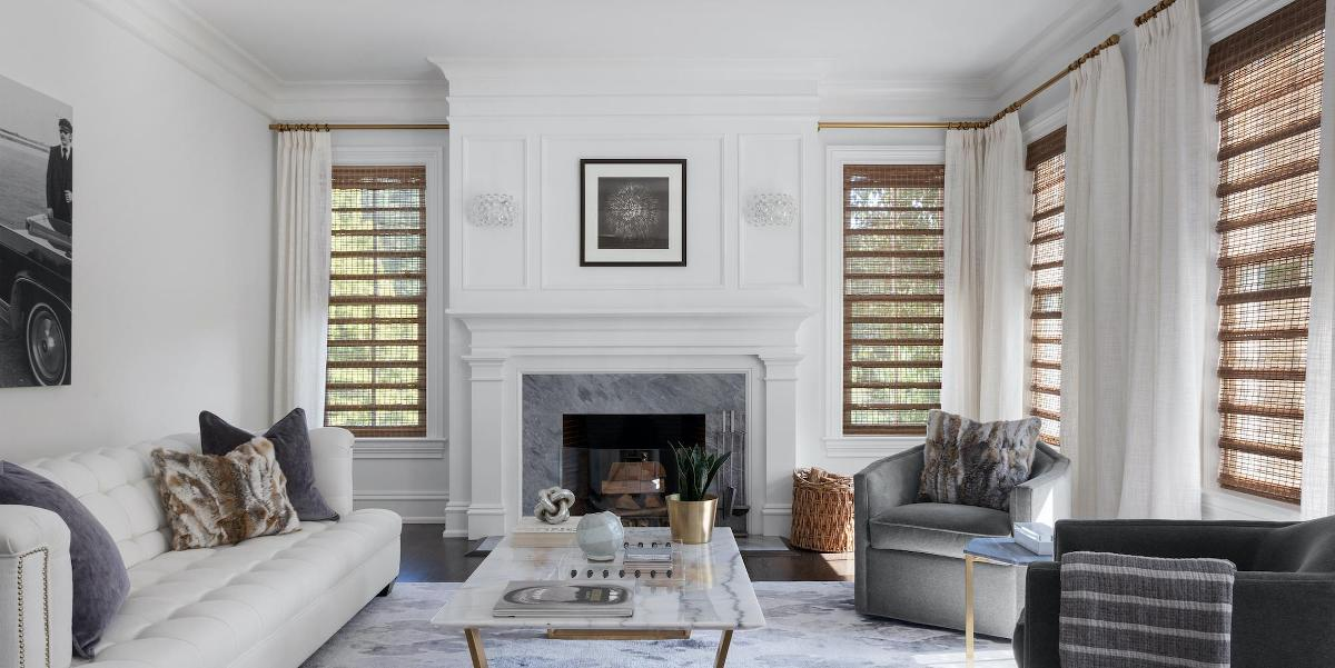 Woven wood shades paired with drapery in a beautiful living room