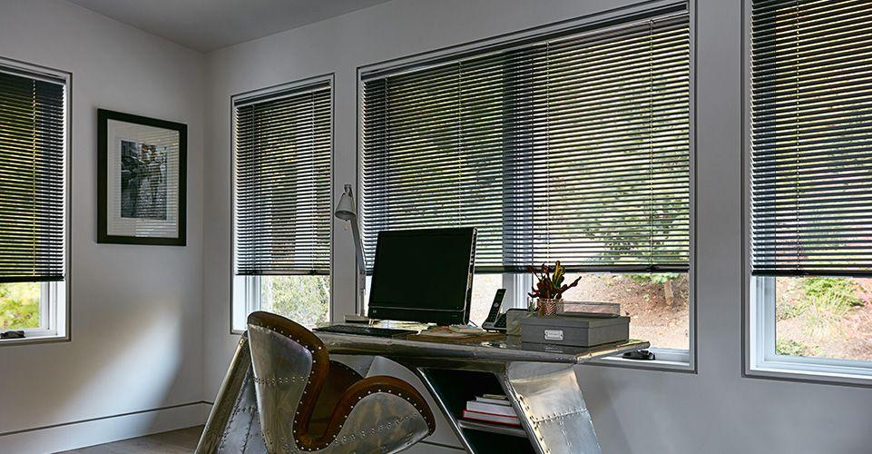 Steam punk themed office showcasing Aluminum blinds, a perfect match.