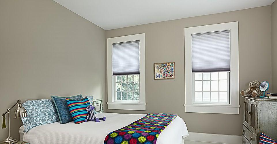 Beautiful bedroom showing off a pair of cellular shades.