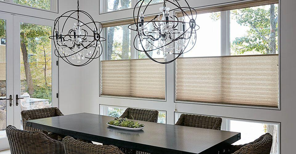 Modern dining room showcasing a nice pair of pleated shades