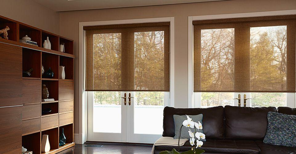 A pair of solar shades keeping the living room cool as well as protecting the furniture from the sun glare.