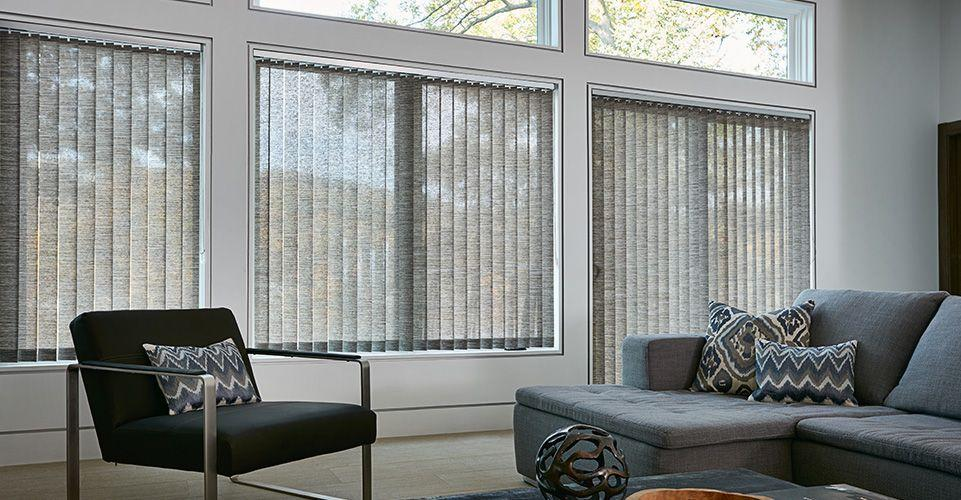 Modern living room setting showcasing vertical fabric blinds.