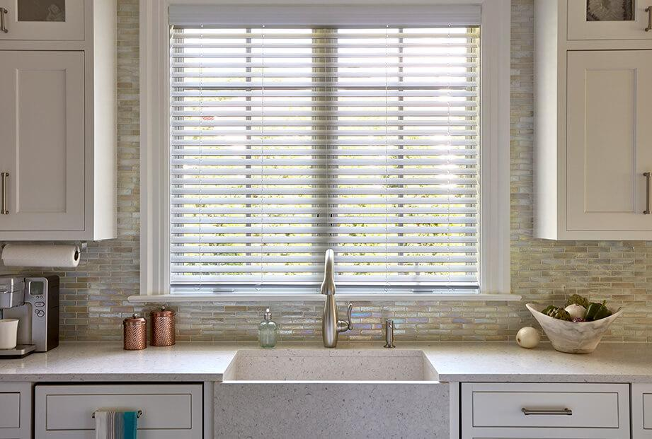 Contoured Faux Wood blinds in this beautiful kitchen