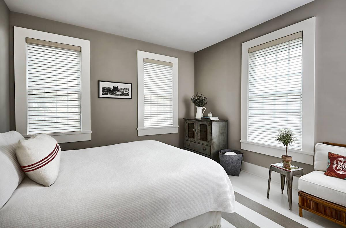 Neutral bedroom with cream colored sheer shades