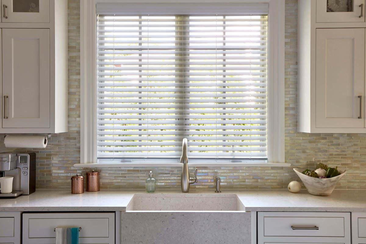 Solar shades Barcelona in Cold Foam color above the kitchen sink.
