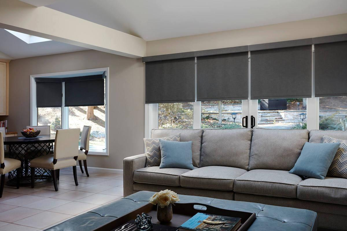 Grey tone living room with charcoal roller shades