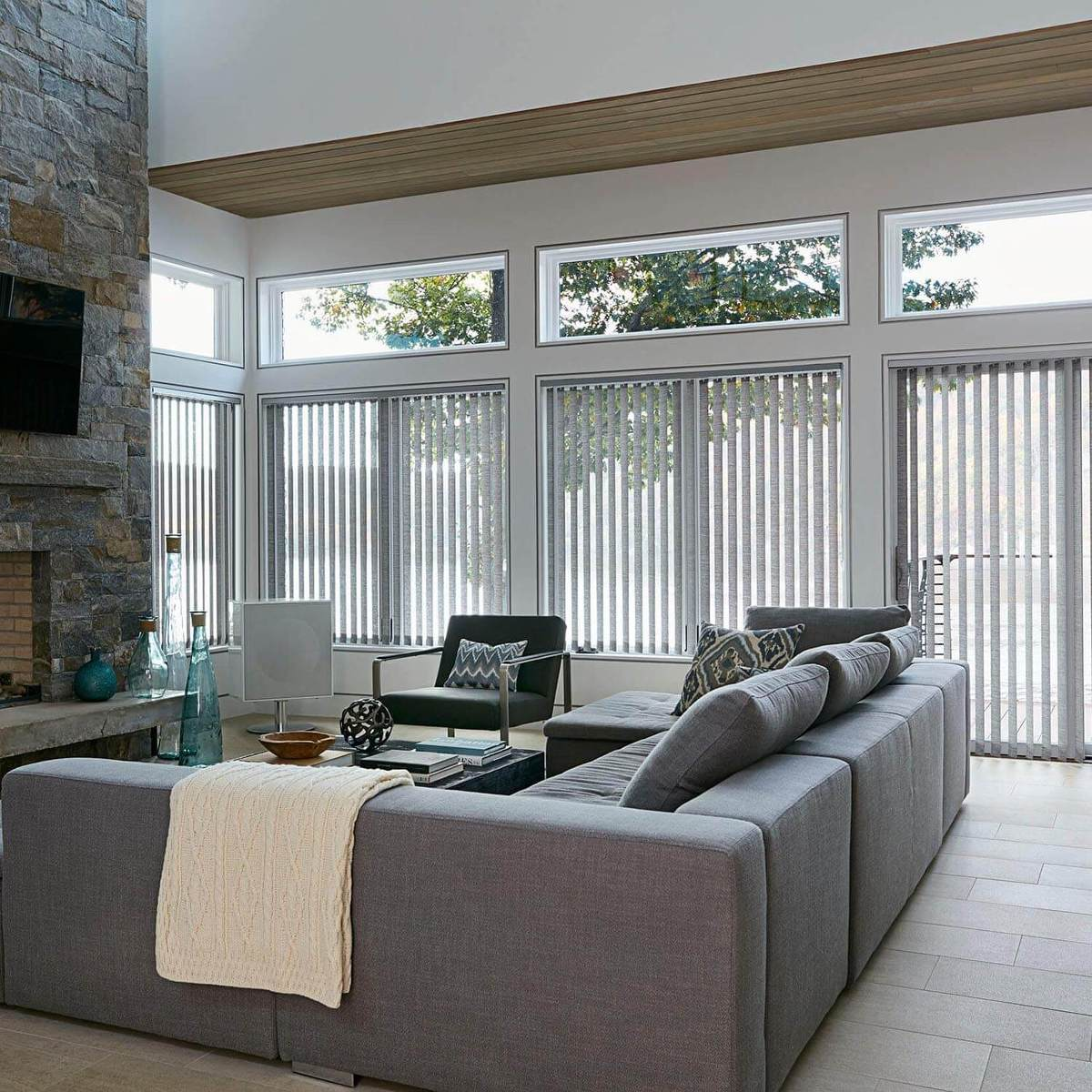 Cordless fabric vertical blinds displayed in this amazing living room space.
