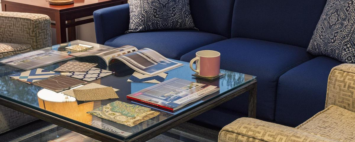Catalogs and samples placed on a table.