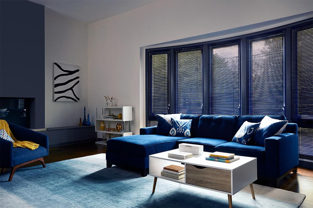 Aluminum blinds Softlook 6 in Blue Cadet for windows side by side in the family room.