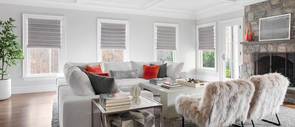 Grey roman shades in a contemporary living room