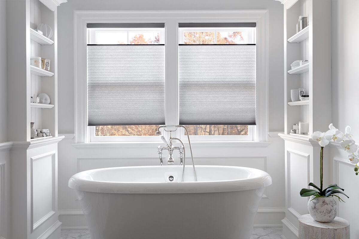 Top down bottom up shades in a white and grey contemporary bathroom