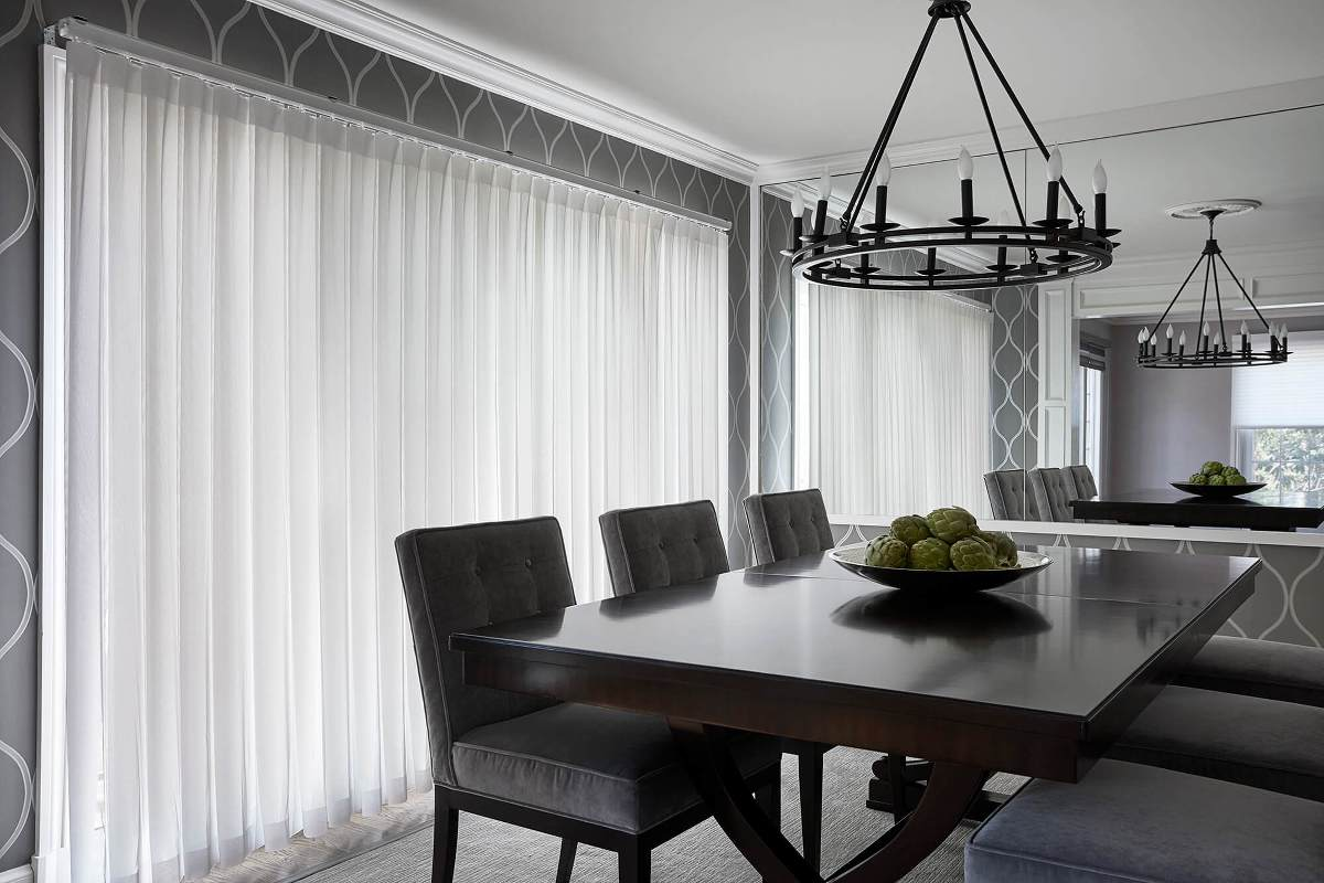 Allure privacy sheer diffuse light beautifully in this dining room.