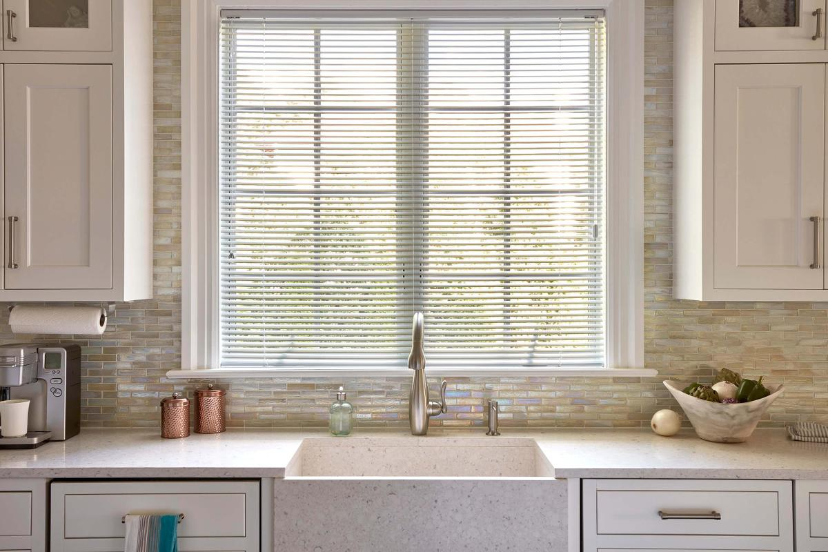 Beautifully displayed Aluminum blinds in this modern kitchen.
