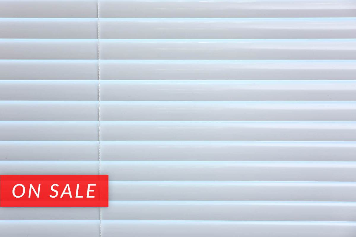 Entry level aluminum mini blinds that comes in white and alabaster colors