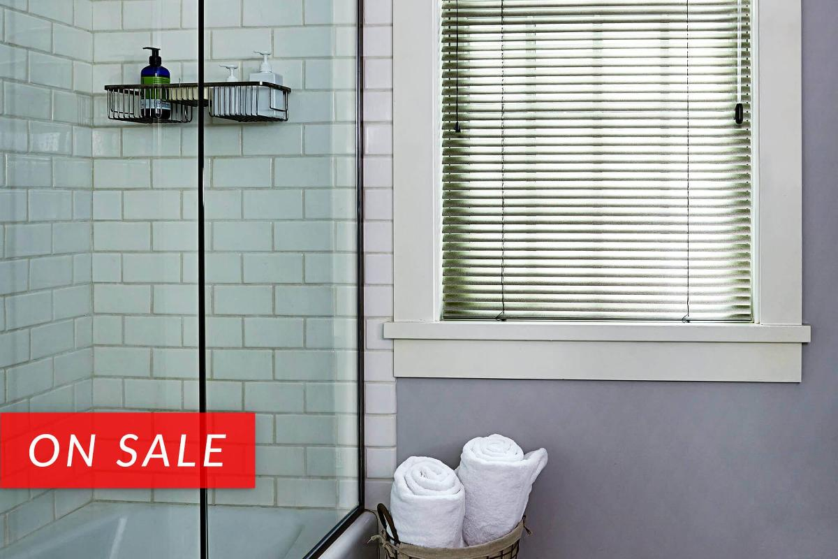 Softlook 8 mini blinds have a thicker aluminum able to withstand wear and tear for bathroom windows near the shower.