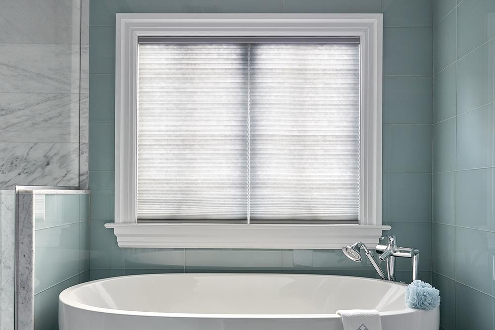 Cellular shades with one headrail and two separate window treatments