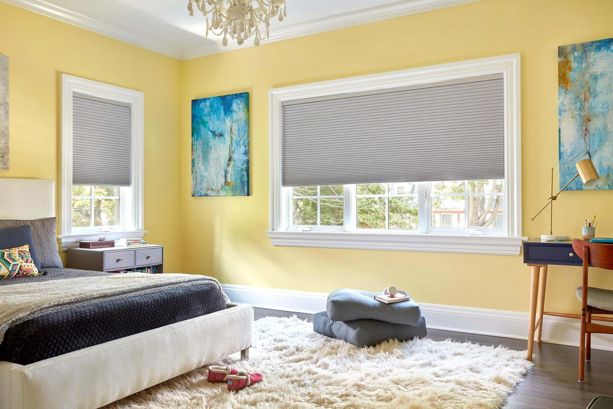 Top down bottom up cordless designer cellular shades in a master bedroom complete this modern decor scheme.