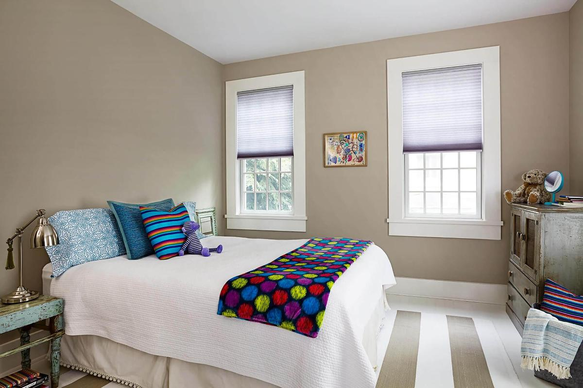 These custom cellular shades provides a clean and finished look to this kids bedroom