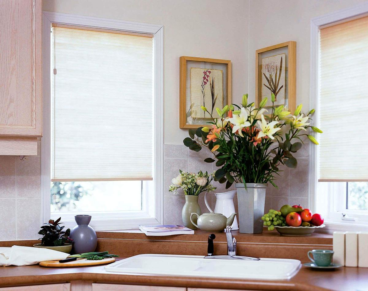 This pure white mirage cellular shade/ honeycomb shade hangs over the kitchen sink