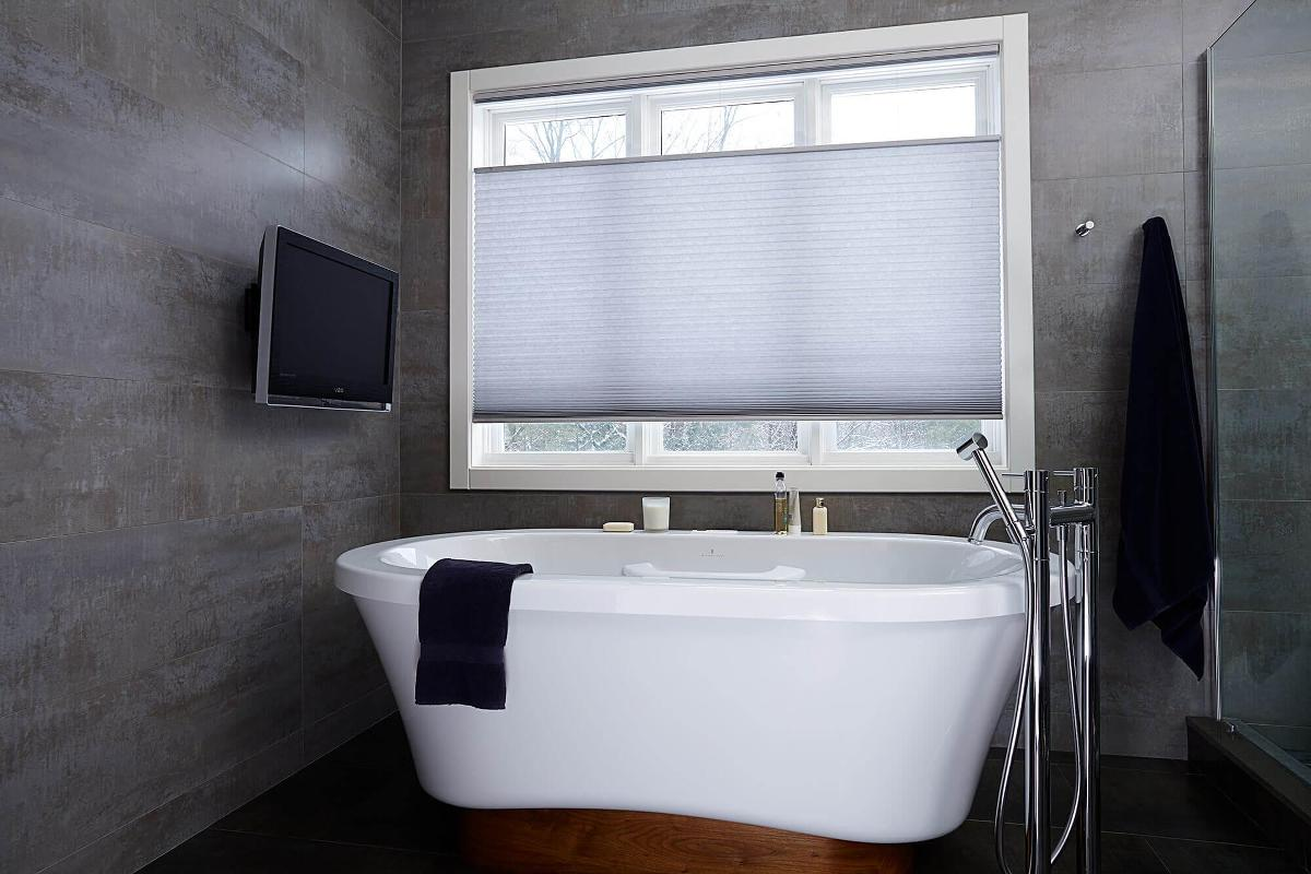 A softer window treatment option is our cellular shade with cordless top down bottom up for a modern bathroom design.