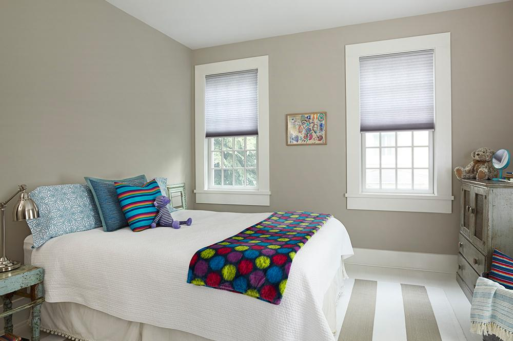 Cordless cellular shades in a bedroom
