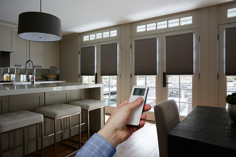 Motorized cellular shades in a living room