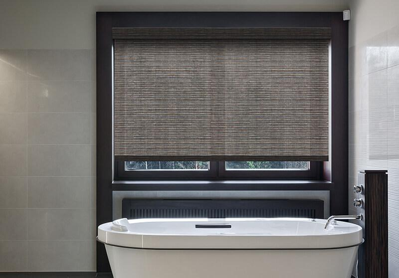 Roller shade with cordless option in a beautiful bathroom.