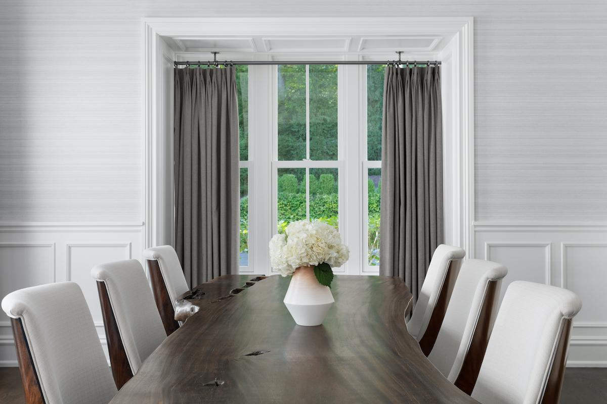Roller shade window treatment in combination with drapery, to complete the look.