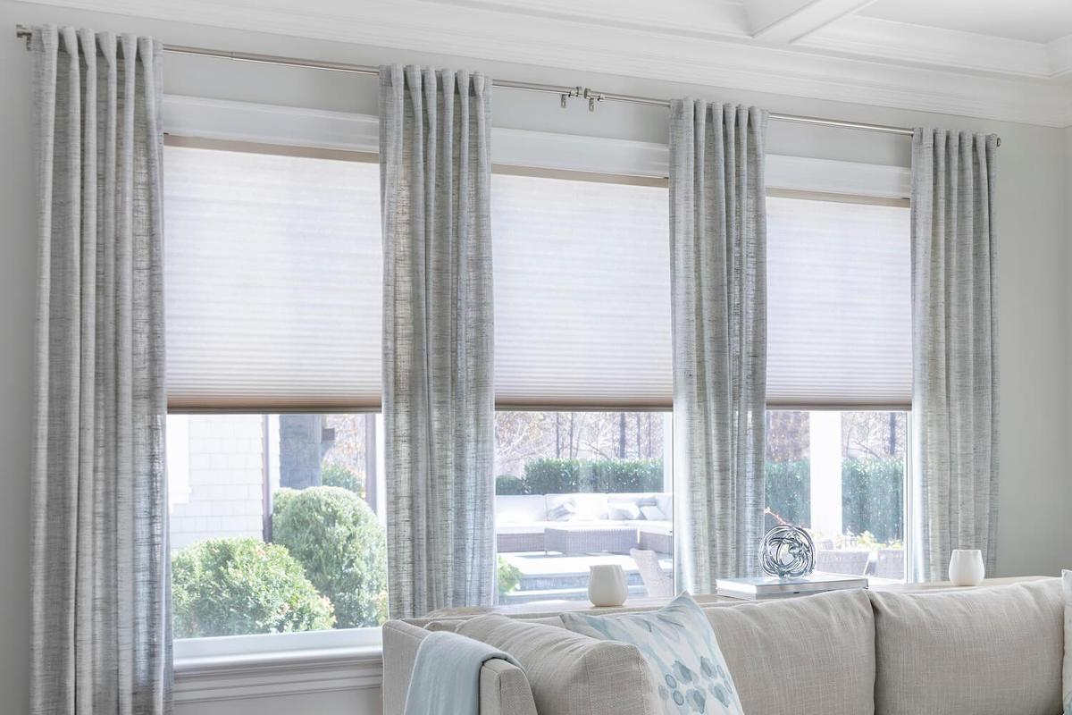 Beautiful drapery window treatment showcasing classical flare.