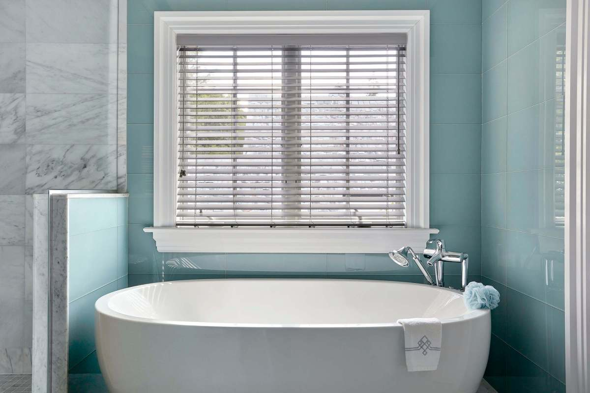 Resistent to warping or fading. Faux wood blind for windows next to  a shower