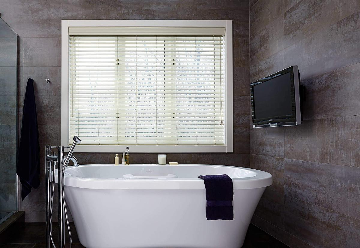 Modern Gray Bath Design With White Faux Wood Blind