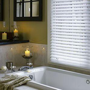 Faux wood blinds great for high humid spaces such as bathrooms and kitchens