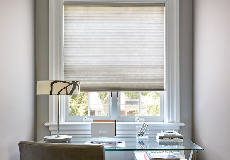 Cellular shades in a home office nook