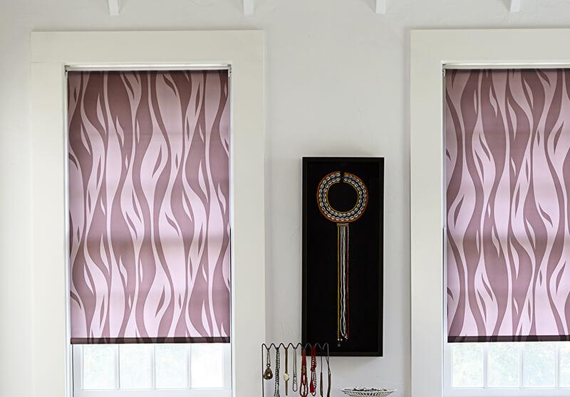 Roller shade with motorized option in a beautiful bedroom.