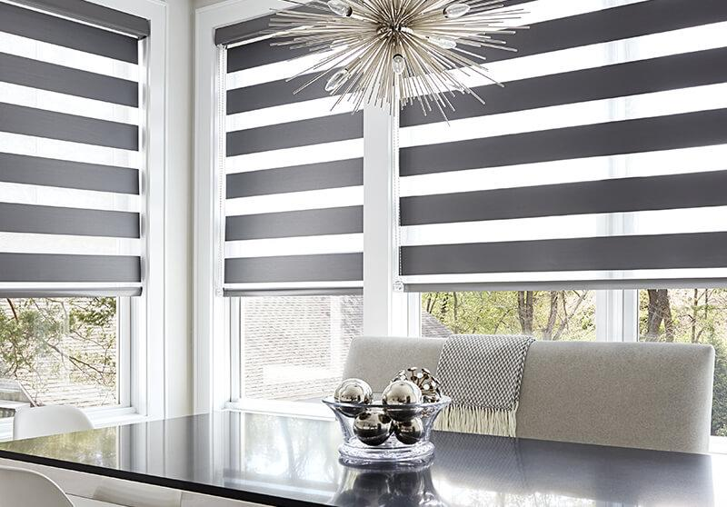 Sheer shade with motorized option in a dining room setting.