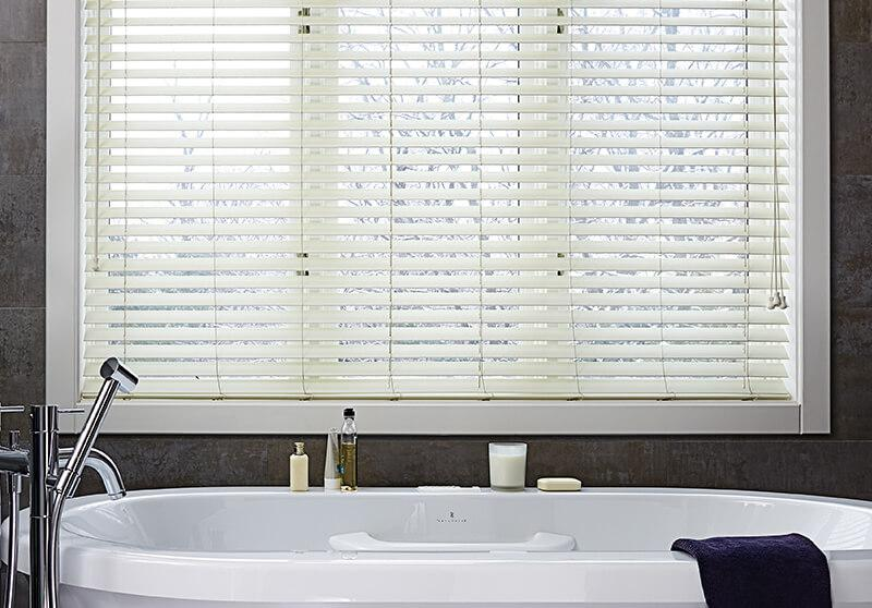 White faux wood blinds with motorized option in a contemporary bathroom