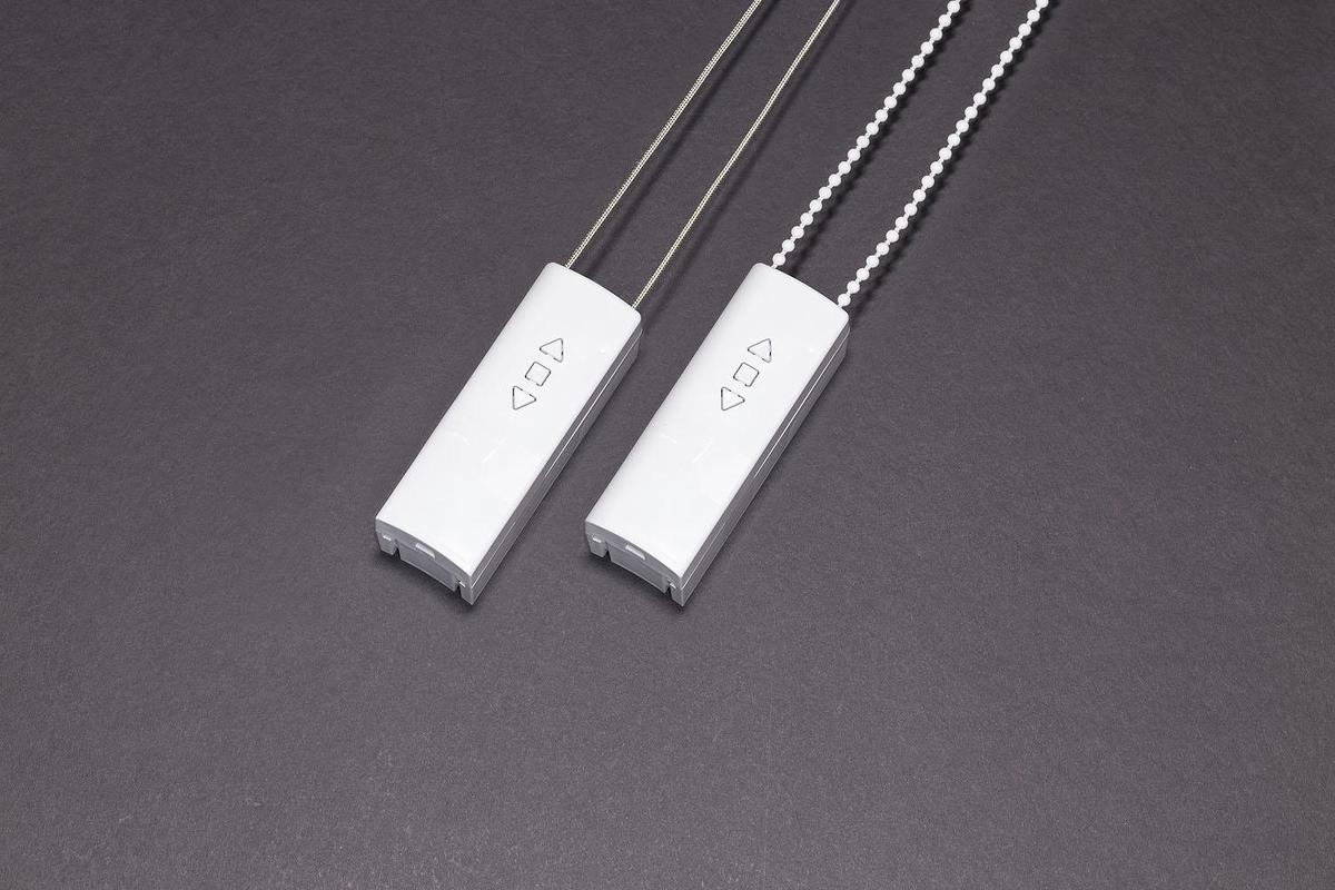 An image of two MOVE controllers, one paired with a regular cord and one with a beaded cord and