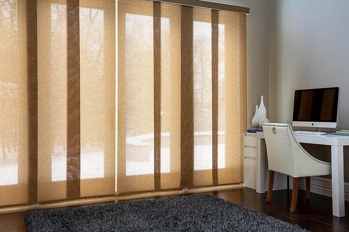 Fabric panel track allows natural light to come in a small study area