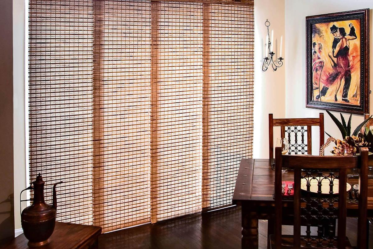 Custom woven wood panel track compliments the dining room furniture