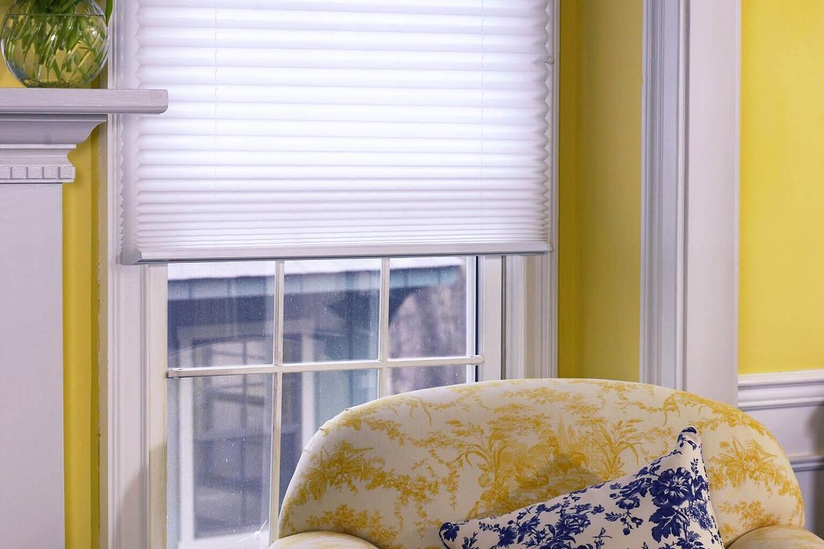 This blue pleated shade really stands out in this family room, compared to most other window treatments.
