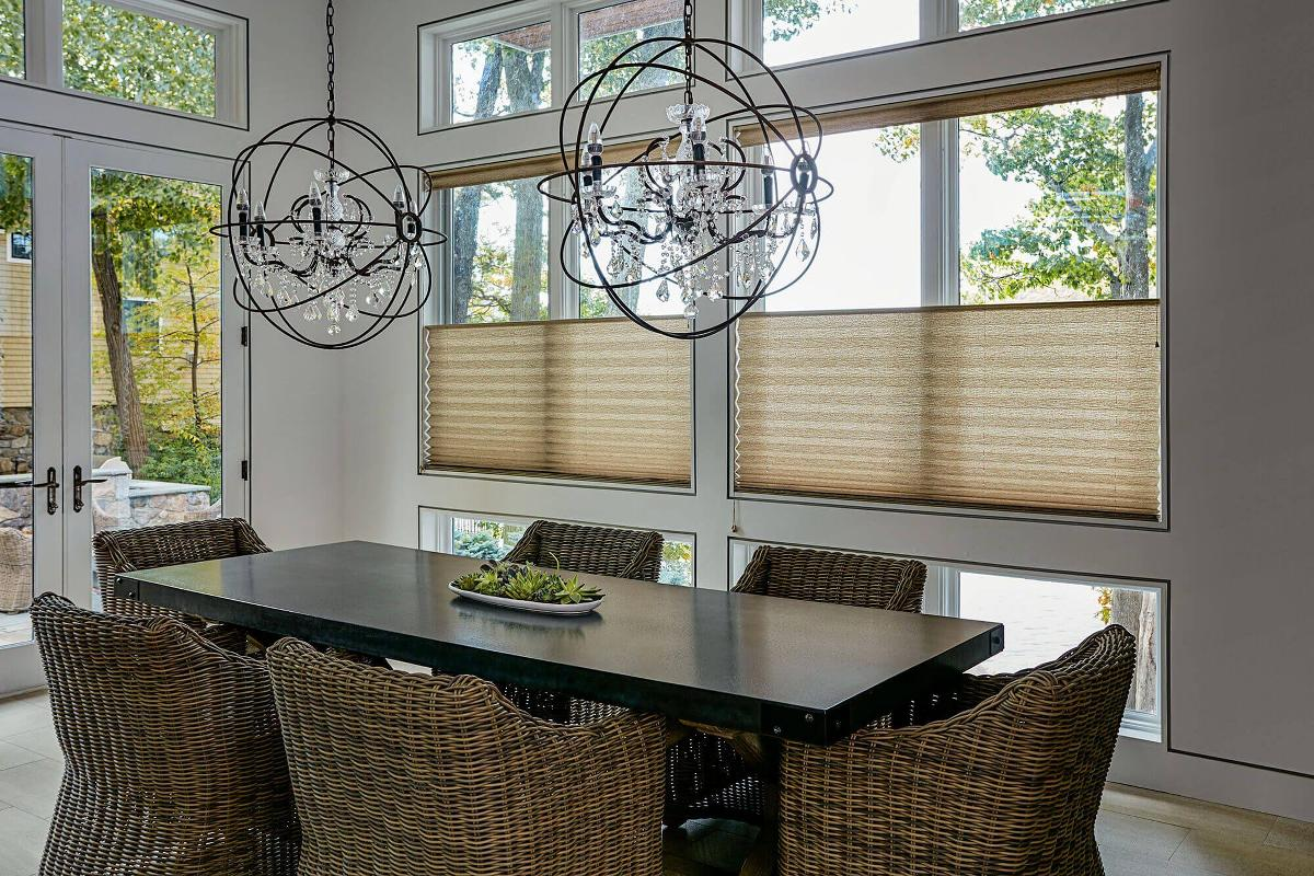 Top down bottom up pleated shades in a recently redesigned dining room, using a modern decor scheme. Shades were purchased at Blinds To Go.