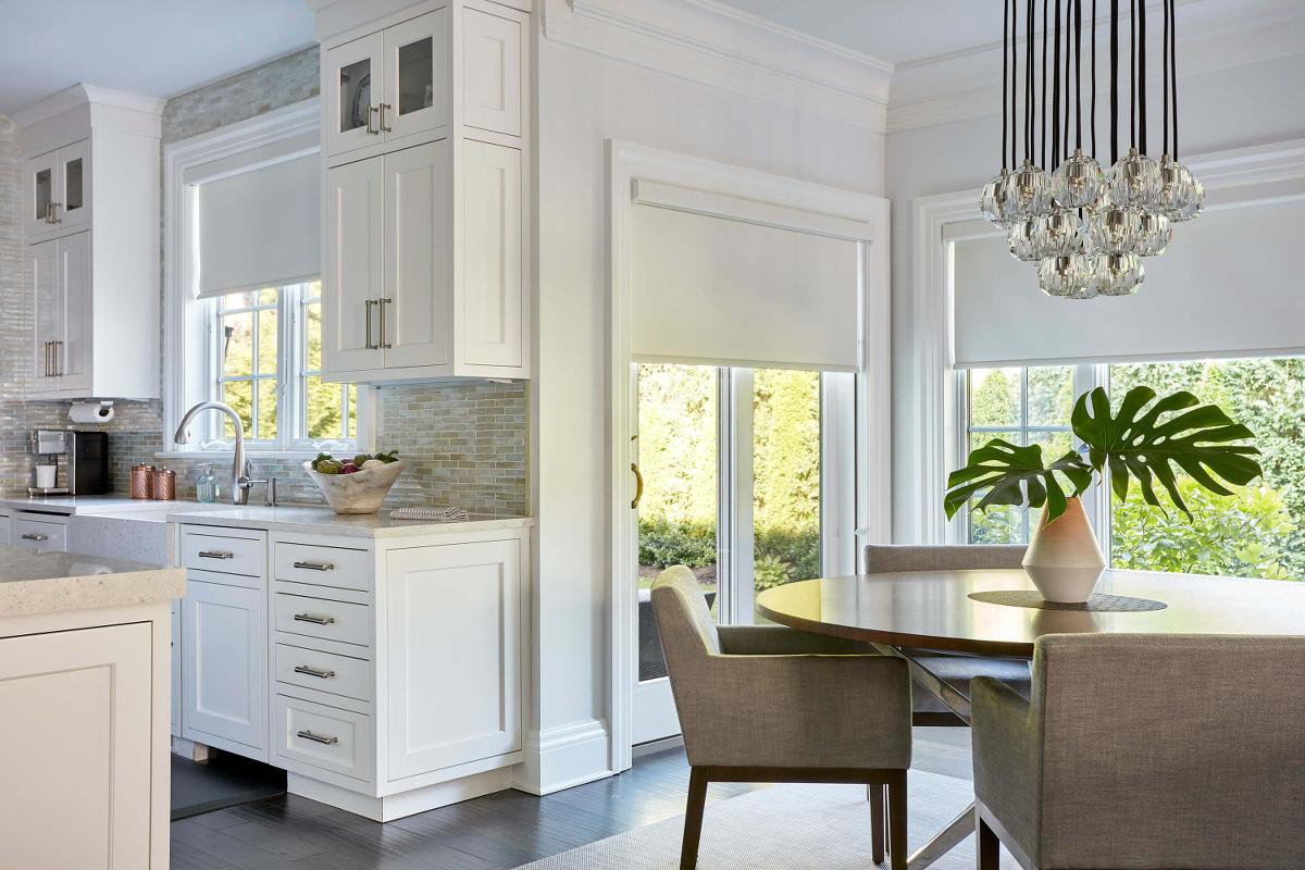 Roller shades in a contemporary kitchen and adjoining dining area