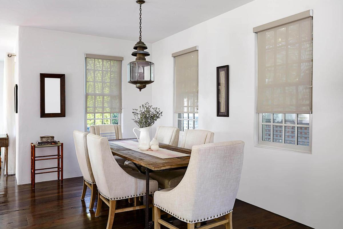 The perfect window treatment to finish this redesigned dining was the Tokyo weave solar shades in a tan color
