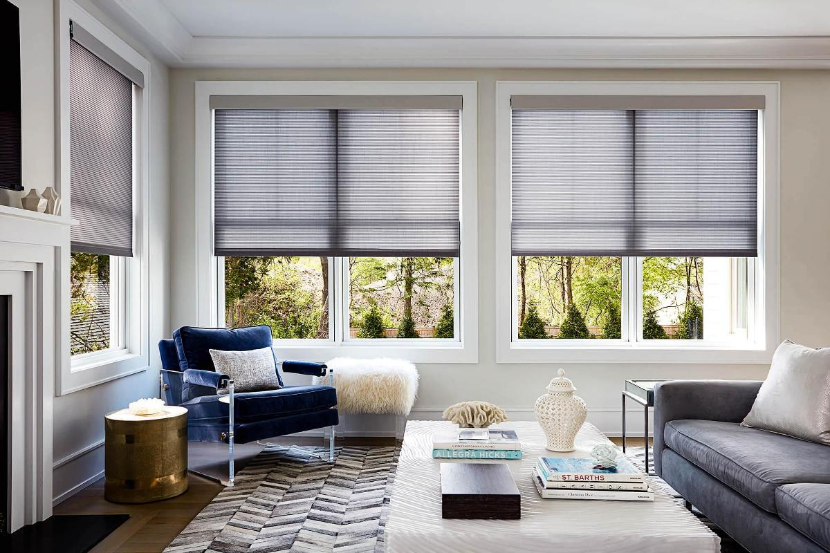 living room window blinds. Dining room setting showcasing our beautifully crafted Illusion Roller  Shades Inspiration Custom Blinds and To Go