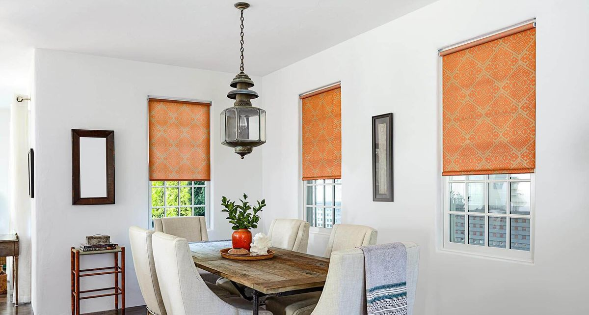 All vinyl roller shades help keep out the light, like you see her in this guest bedroom window treatment