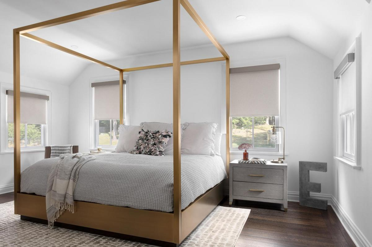 Cordless roller shades in a large, contemporary bedroom