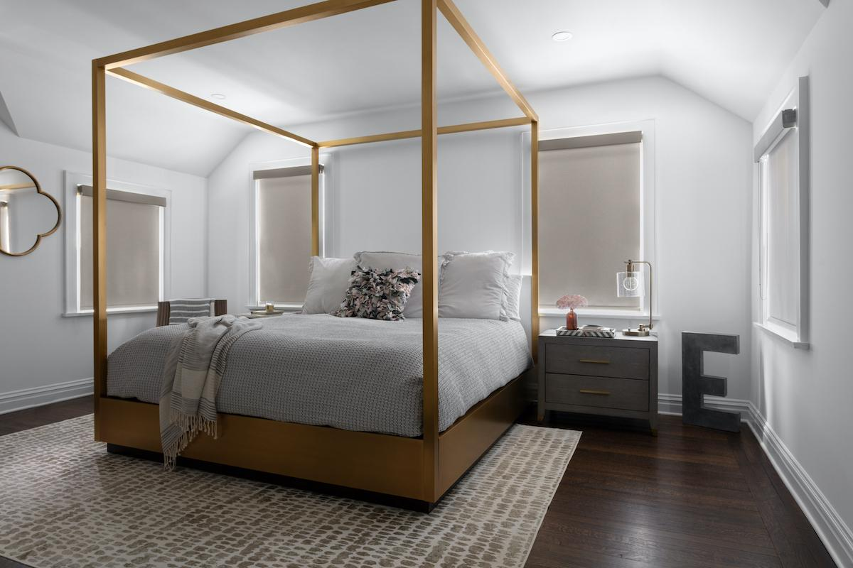 Tan roller shades in a modern bedroom